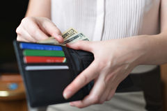 Purse with money in woman`s hand Stock Images