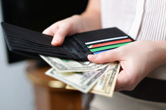 Purse with money in woman`s hand Royalty Free Stock Image