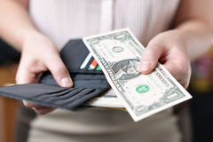 Purse with money in woman`s hand Royalty Free Stock Images
