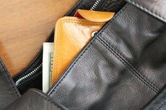 Purse with money Stock Photos
