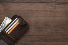 Purse with money on the wooden table Royalty Free Stock Images