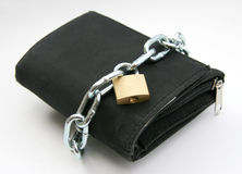 Purse with padlock 2. A wallet with a chain and padlock - symbolic for safety precautions on either spending money or pick-pocketing Stock Photos