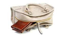 The purse sticks out of a female handbag Royalty Free Stock Image