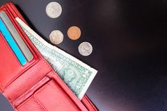 Red purse with small money. Stock Image