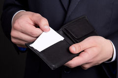 Purse with visiting card in business man hand Stock Images