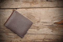 Purse on wood background Stock Images