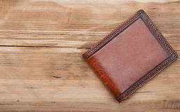 Purse on wood background Royalty Free Stock Photo