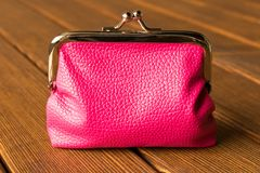 Purse on a wooden table . On wooden background royalty free stock image