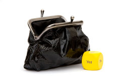 Purse with yellow dice Royalty Free Stock Image