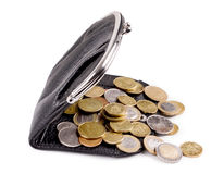Purses and gold coins. On a white background Royalty Free Stock Image