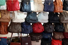 Purses. Leather purses with various colors on sale in an Italian market in Florence.  Famous leather industry in Florence, Italy Royalty Free Stock Photos