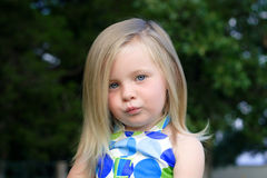 Pursing the Lips. A young toddler purses her lips together to keep from smiling Stock Photo