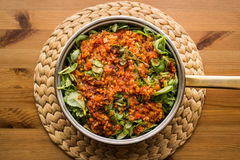 Purslane food with tomato sauce in a pan on a wicker. Stock Image