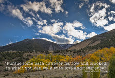 Pursue some path. Beautiful scenic landscape in autumnal mountains and the following positive quote by Henry David Thoreau pursue some path however narrow and stock photo