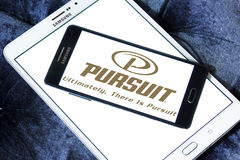 Pursuit boats logo. Logo of boat and yacht manufacturer pursuit on samsung mobile phone on samsung tablet Royalty Free Stock Image