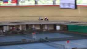 Pursuit on the cycling track stock video footage
