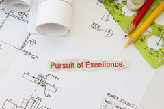 Pursuit of excellence. Abstract with engineering tools and hard hat Stock Photo