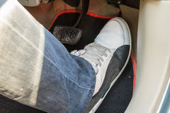 Push accelerator pedal of the car. Driver's push accelerator pedal of the car Royalty Free Stock Image