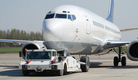Push back. Pushing back of narrow body aircraft royalty free stock photography