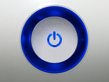 Push the Button. Power button with a ligting blue border royalty free stock image