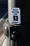 Push button for crossing. Close up of a push button for crossing signal and button at a pedestrian intersection. Shallow depth of focus that includes a portion Stock Images