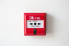 Push button switch fire alarm box on cement wall Royalty Free Stock Photo