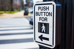 Push button to cross road crosswalk sign Stock Image