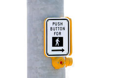 Push Button to Cross Street. A yellow push button sign used to cross the street Stock Photos