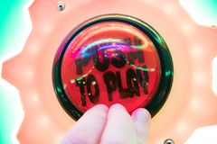 Push button to play arcade. Arcade game push button to play. Playing arcade game Royalty Free Stock Images
