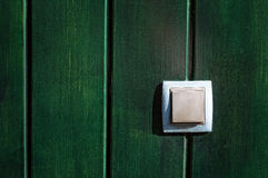 Push button on wooden wall Royalty Free Stock Image