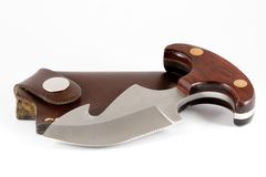Push dagger and sheath. Detail studio photograph of a push dagger with a leather sheath stock photos
