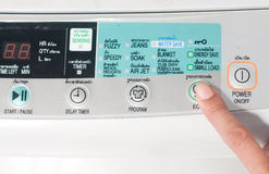 Push eco button washing machine Royalty Free Stock Photo