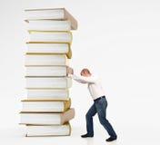 push för bokmanstapel arkivbilder