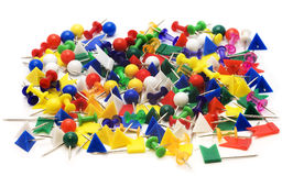 Push index pins. Heap of colorful stationery buttons. Isolated Stock Photos
