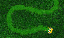 A push lawn mower draws a path Royalty Free Stock Photo