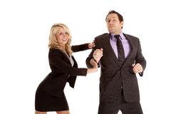 Push man. A business man and woman pushing and trying to get there first Royalty Free Stock Image