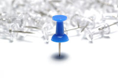 Push-pin. White and blue push-pin on white background Stock Photo