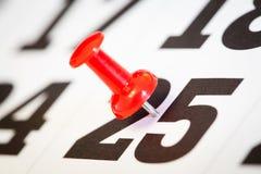 Push-pin in calendar.Close-up. Royalty Free Stock Photos