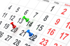 Push pin in calendar. On white background royalty free stock photos