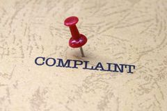 Push pin on complaint text Royalty Free Stock Image