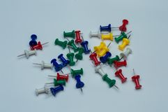 Colorful pushpin collection on white background stock photos