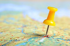 Push pin. In a map, close up Stock Photos