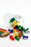 Push pin and multicolored pencils Stock Photo