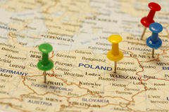 Push Pin In Poland. Push pin on an old map showing travel destination stock images