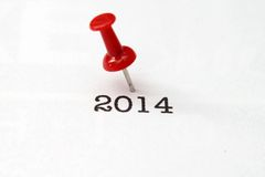 Push pin on 2014 text Royalty Free Stock Images