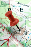 Push Pin on Topographical Map. Red Push Pin on Topographical Map Indicating Location of Mining Claim royalty free stock image