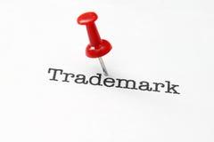 Push pin on trademark text. Close up of Push pin on trademark text royalty free stock photos