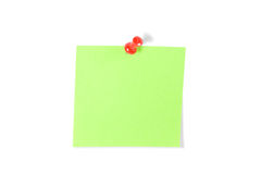 Push-pinned Post-It Note. Red push pin and green Post-It Note isolated on white Royalty Free Stock Photo