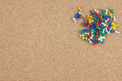 Push pins on brown cork board Stock Images