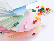 Push Pins and colorful sheets Stock Images